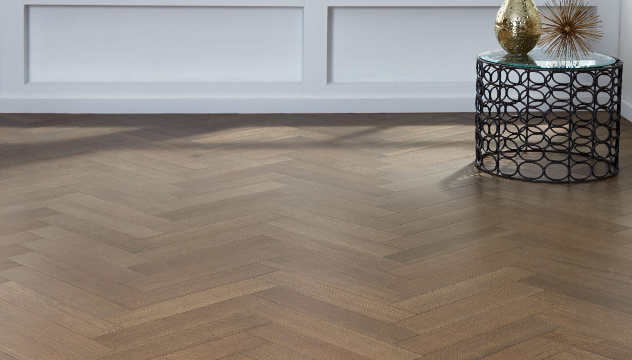 Up the wow factor of your decor with herringbone wood floors for Wide plank wood flooring