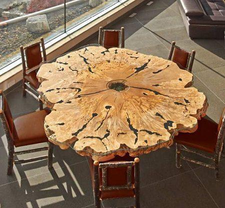 Live edge dining room table on Carlisle Wide Plank Floors Blog