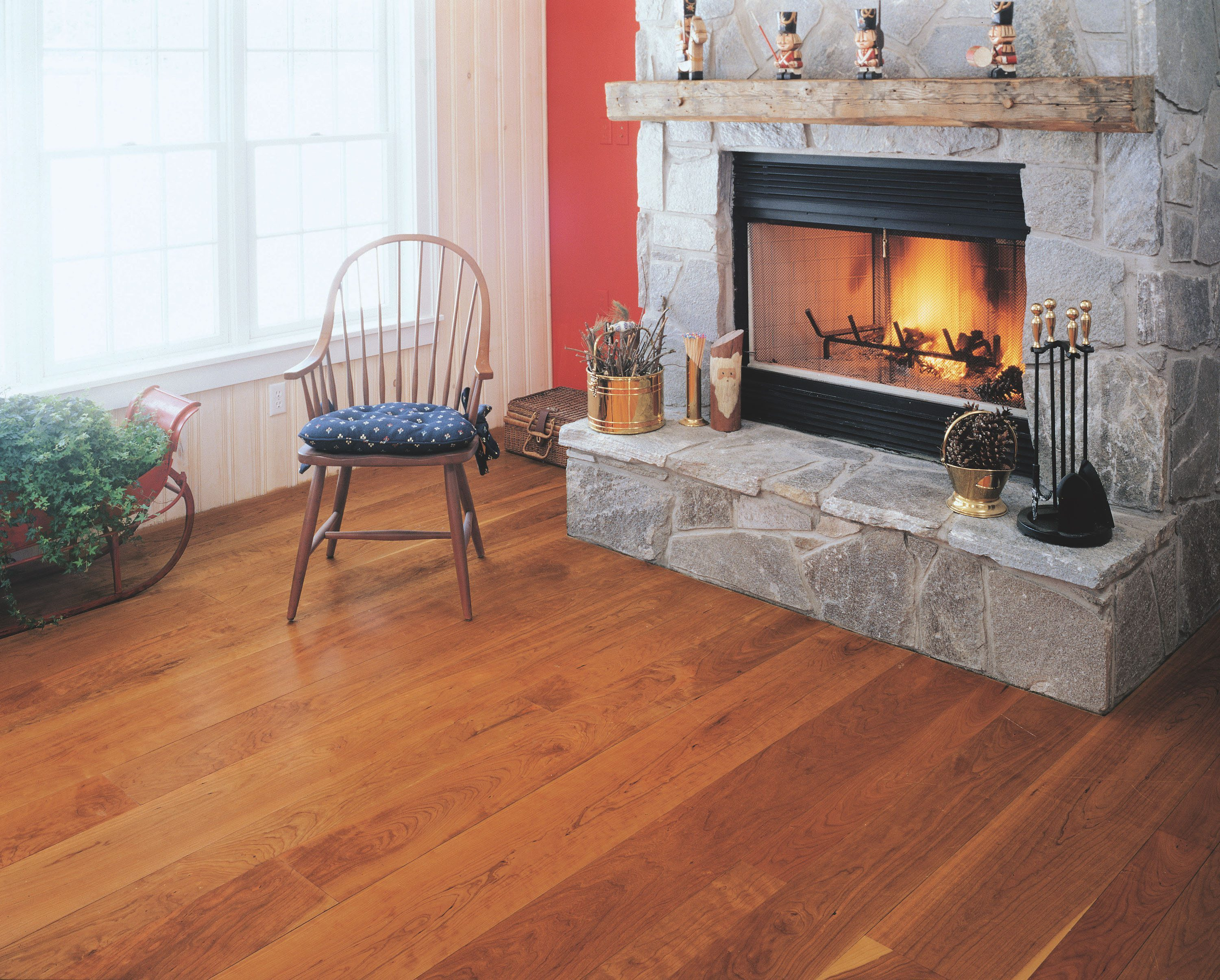 Cherry Wood Flooring With A Stone Fireplace
